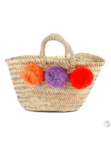 Panier marocain design avec poignées en corde tressée et pompons orange, violet et rouge